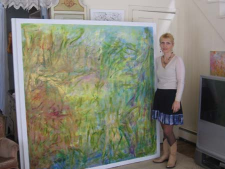Lara with one of her paintings